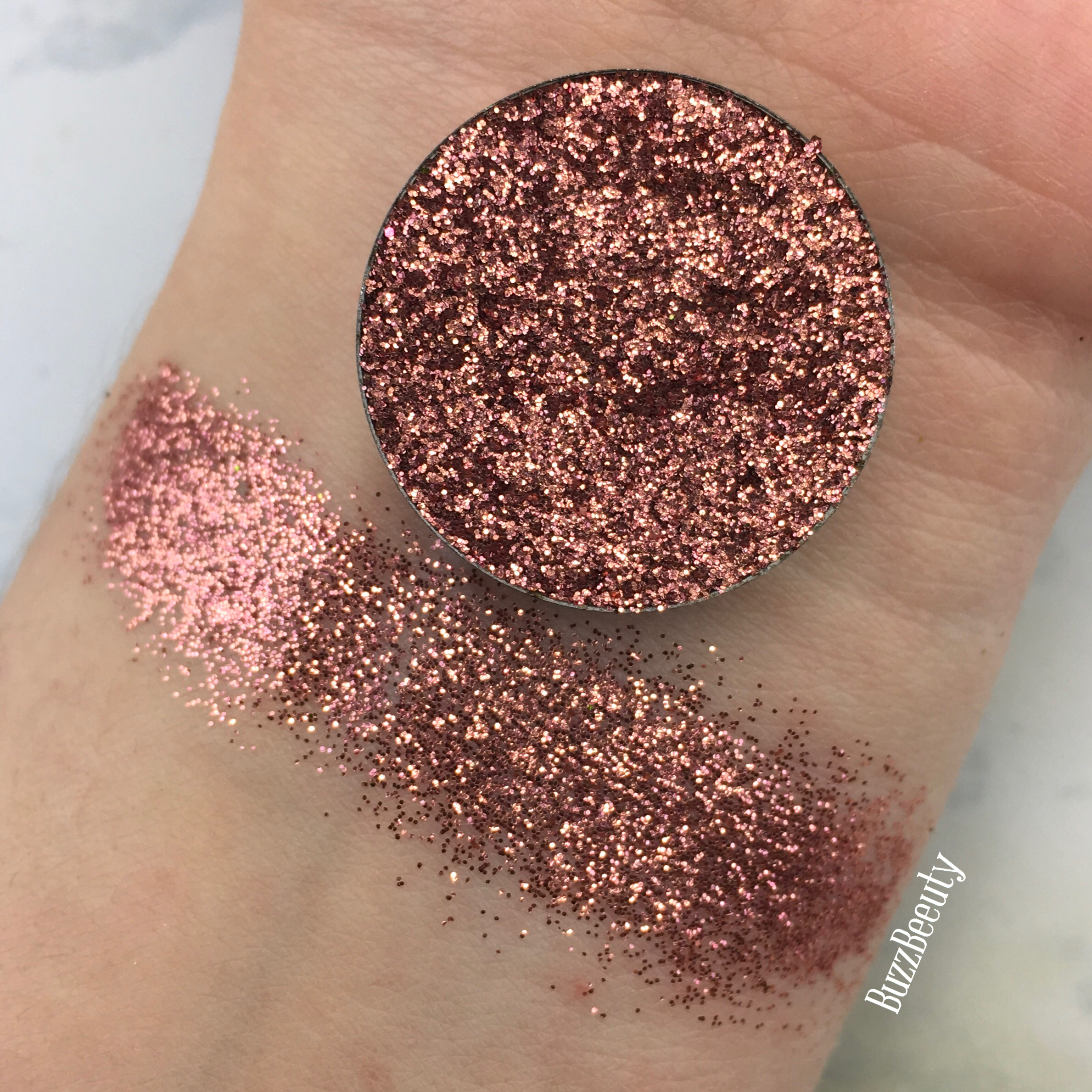 Dear Katie Brown Pressed Glitter Swatch in Leslie. Warm Copper/rose gold metallic glitter.