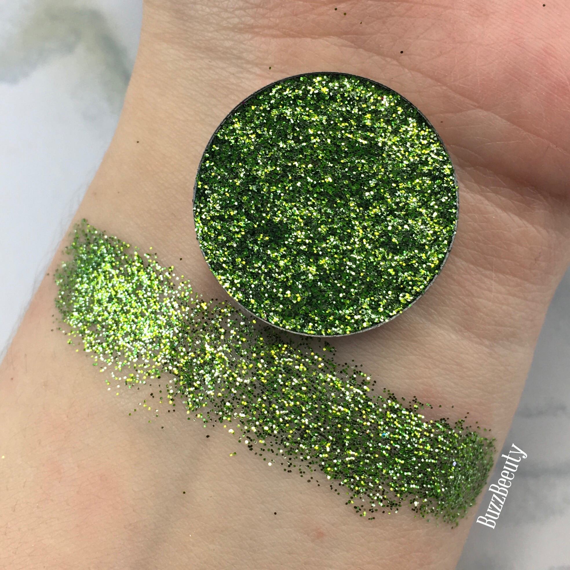 Dear Katie Brown Pressed Glitter Swatch in the shade Mash Up. True dark green with lime green glitters.