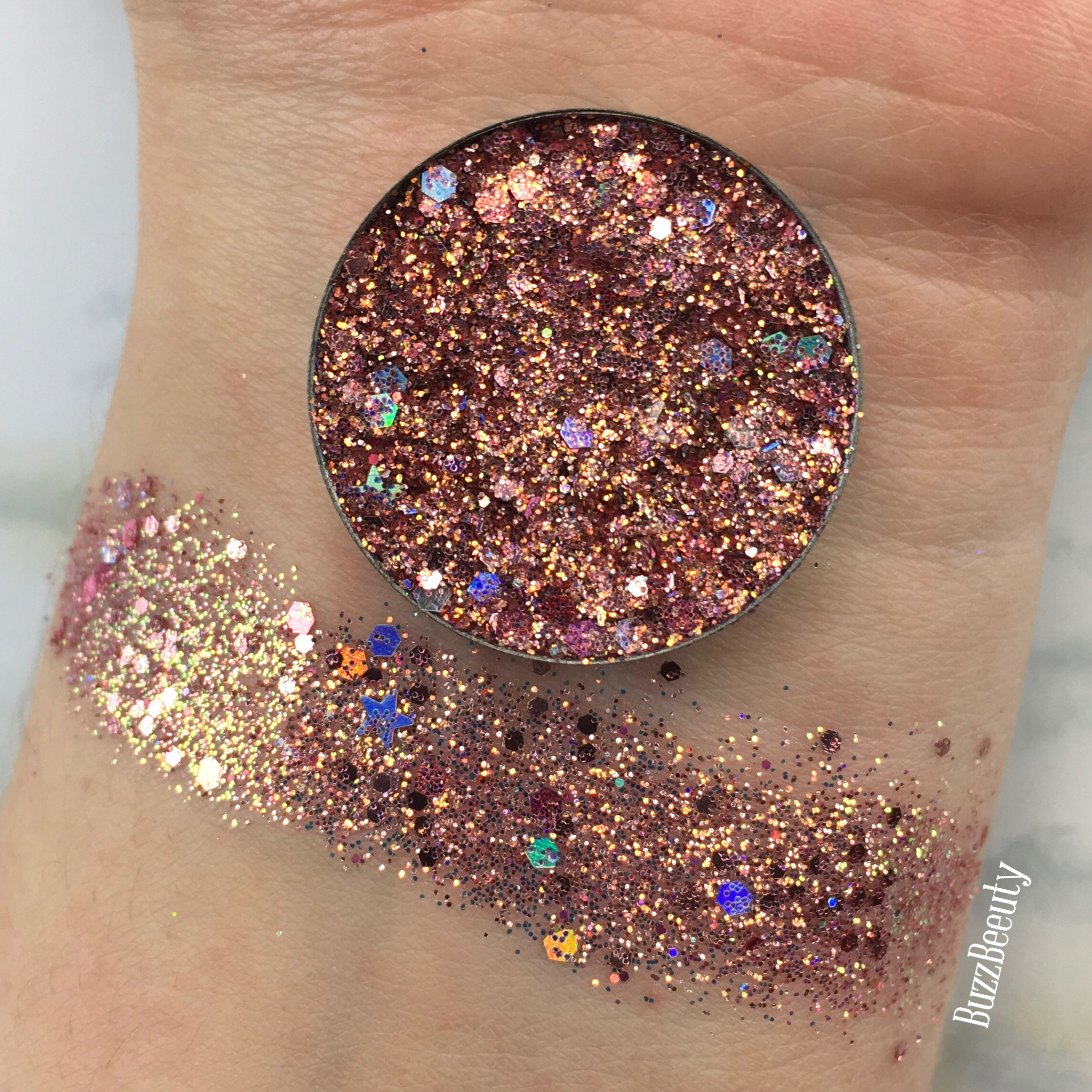 Dear Katie Brown Pressed Glitter Swatch in Spiritual Rebllion. Copper/Rose Gold base with chunky holographic glitters.