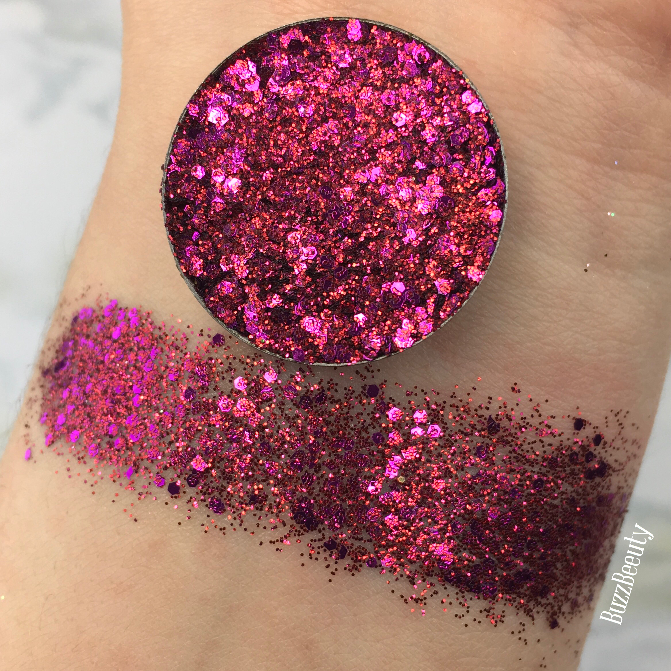 Dear Katie Brown Pressed Glitter Swatch in Tracy. Bright fushia Pink with purple glitters.